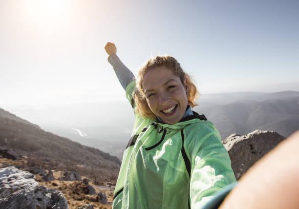 hiker taking a selfie on the top of the hill - jogging hill bildbanksfoton och bilder