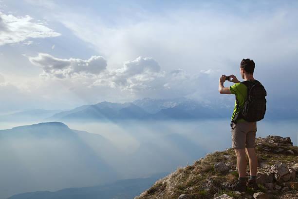 Hiker taking photo of beautiful mountain landscape picture id497548756?b=1&k=6&m=497548756&s=612x612&w=0&h=eipytjgvuqgzf3btsppn kbbdfpxyuqmhtmcf hhev8=
