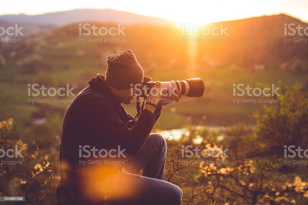 Hiker taking photos stock photo