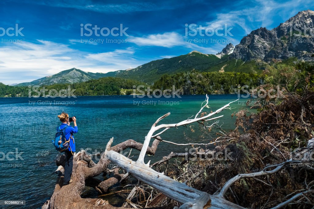 Hiker taking pictures of the mountains stock photo