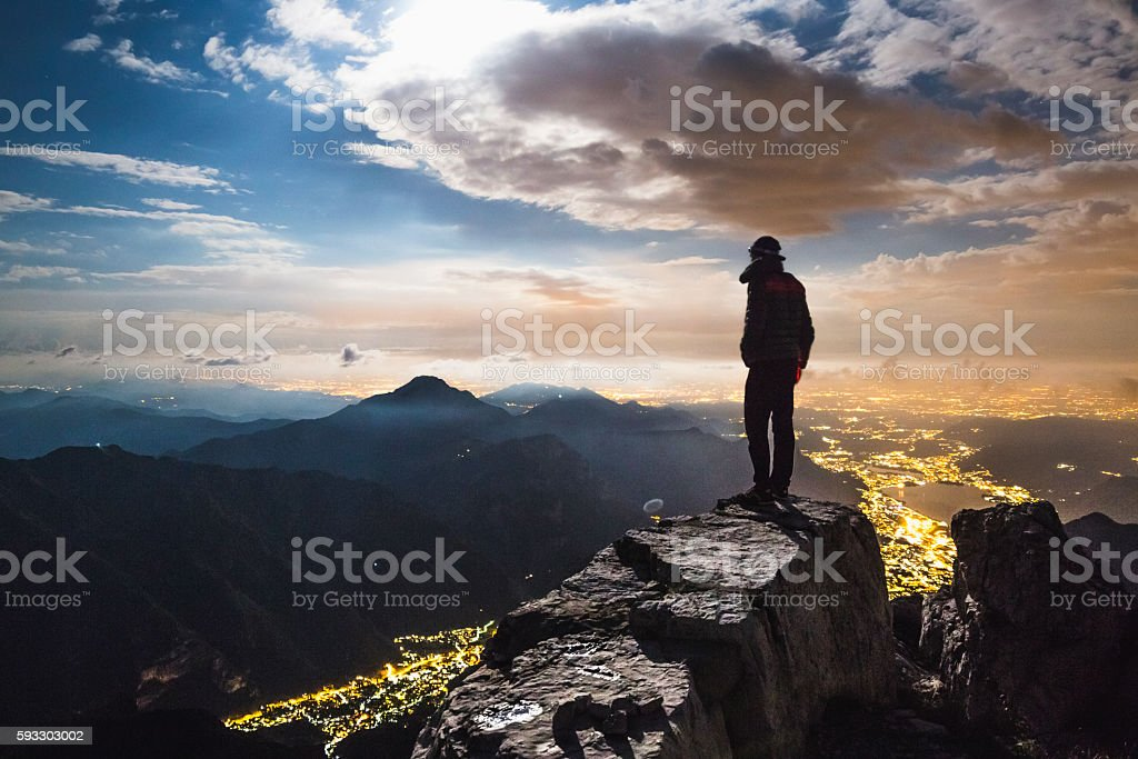 Hiker top of the mount at night stock photo