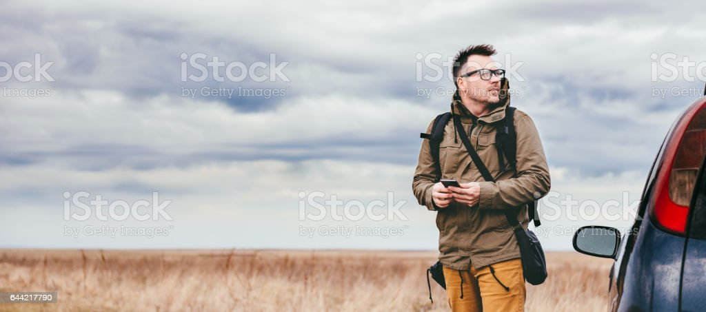 Hiker using smart phone outdoor stock photo