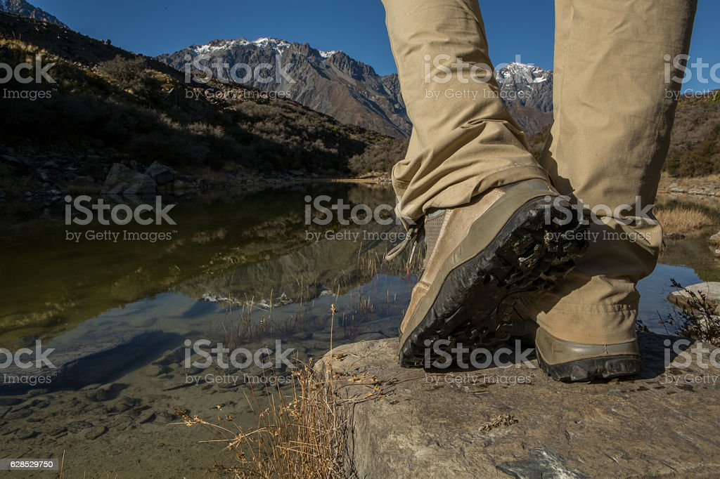 Hiker walk on a mountain trail stock photo