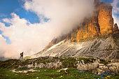 Hiker walk under the mountains Tre Cime di Lavaredo National Park, Dolomites, European Alps, Italy,Nikon D850