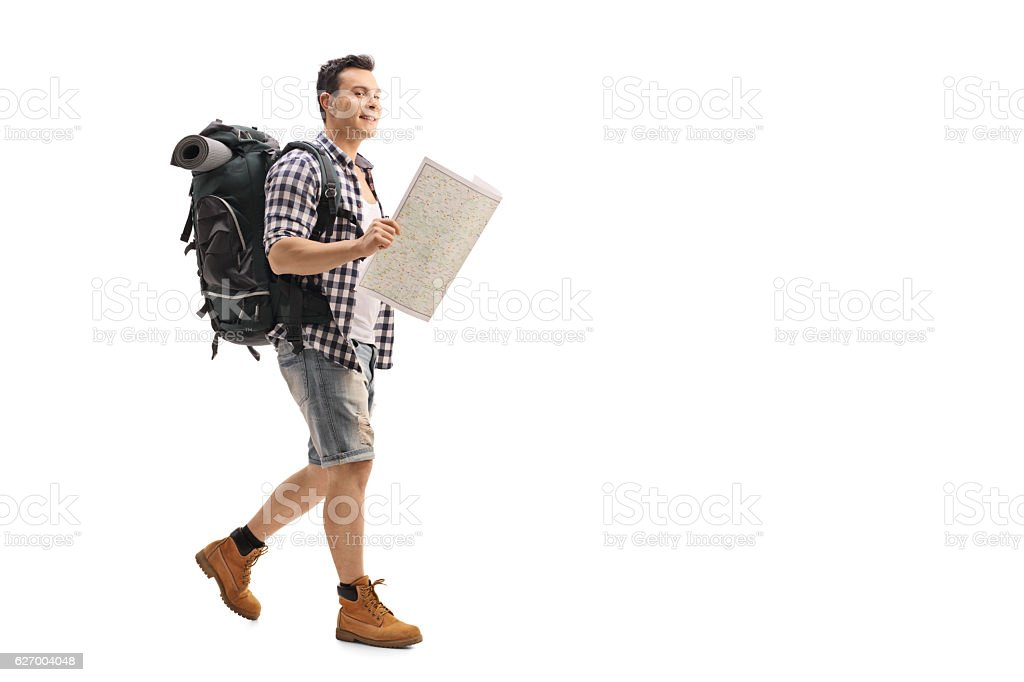 Hiker walking and holding a generic map stock photo