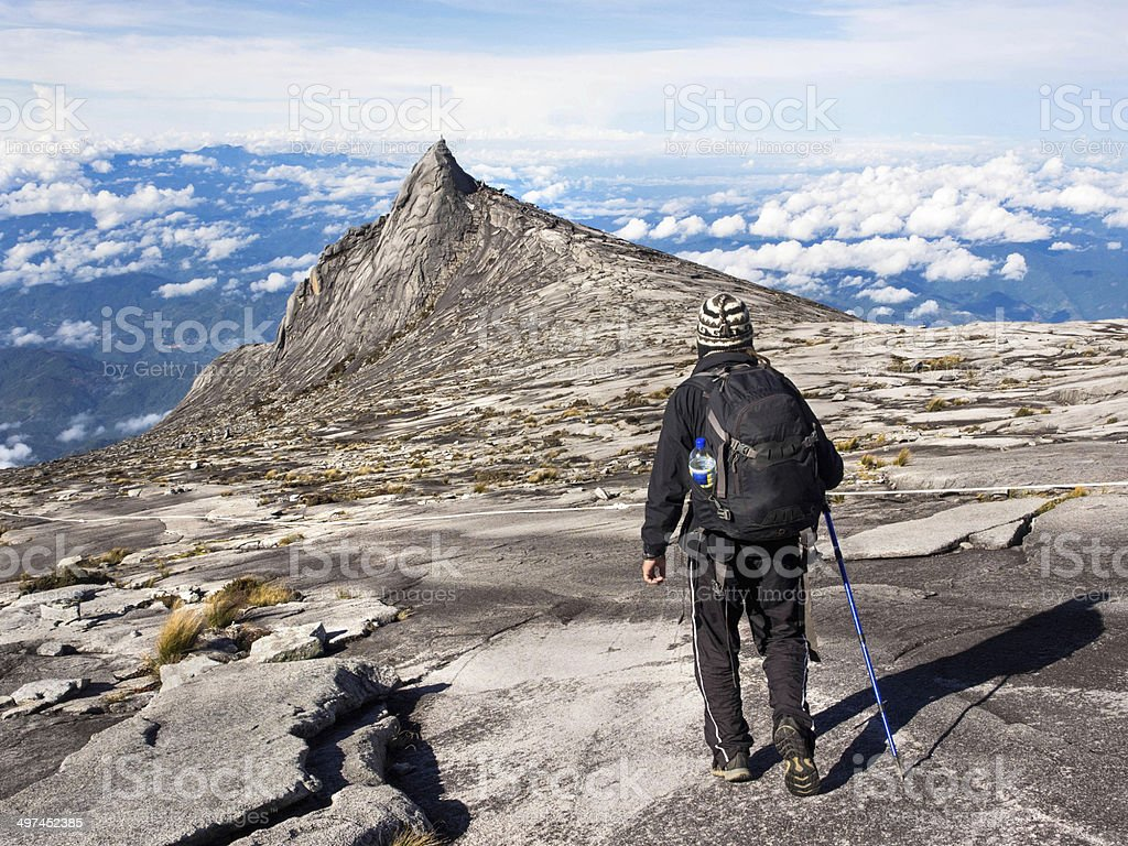 Hiker Walking at the Top of Mount Kinabalu, Sabah, Malaysia stock photo