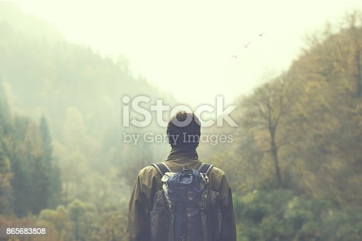 hiker walking in a mystic forest