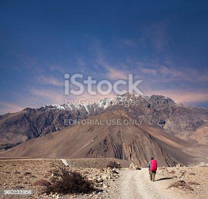 istock Hiker walking on the road on Annapurna Circuit trek, Nepal 960233956