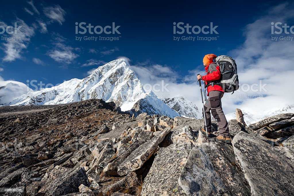 Hiker walks on train in Himalayas stock photo