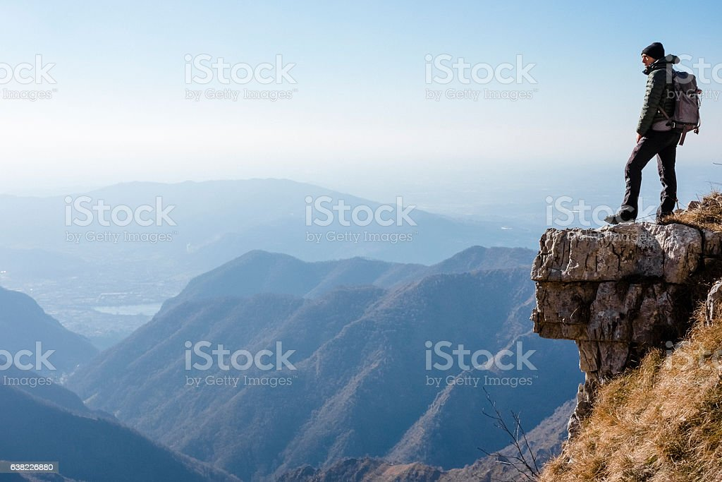 Hiker watches a mountain valley stock photo