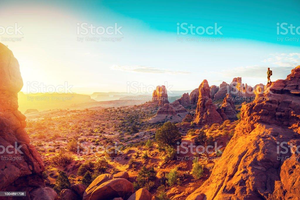 Hiker watching sunrise over Utah valley stock photo