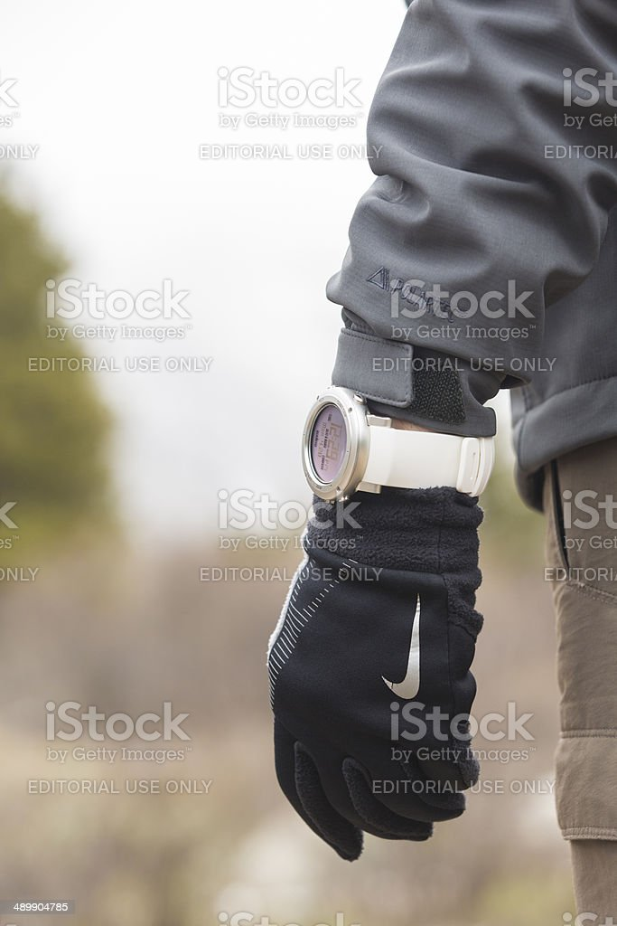 Hiker wearing gloves and a Suunto altimeter watch royalty-free stock photo