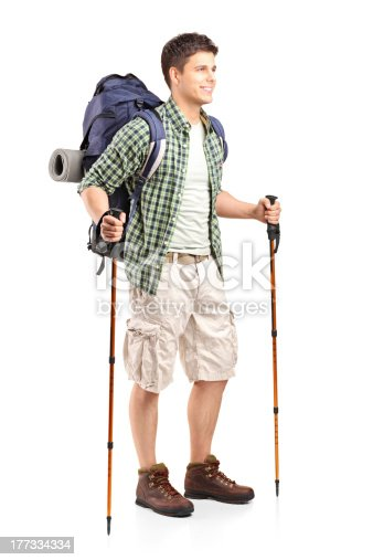 istock Hiker with backpack holding hiking poles 177334334