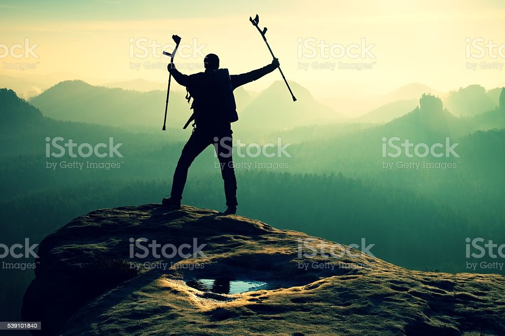 Hiker with broken leg in immobilizer. Tourist with  medicine crutch stock photo