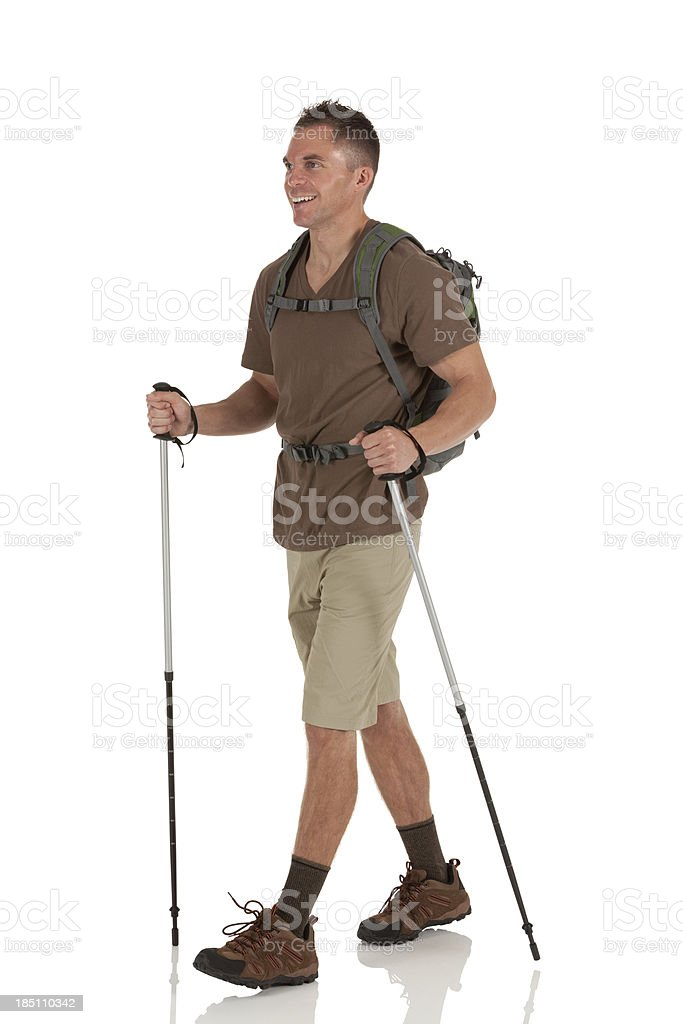 Hiker with hiking poles stock photo