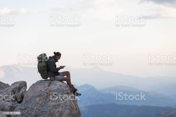 Photo of Hiker With Mobile Phone And Backpack
