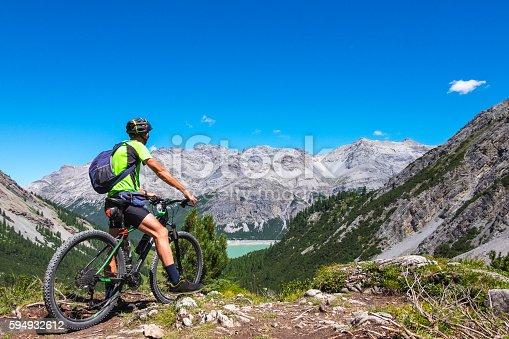 istock Hiker with mountain bike 594932612