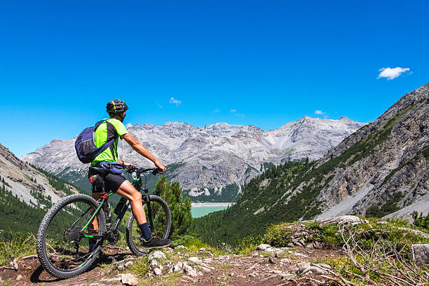 Hiker with mountain bike stock photo