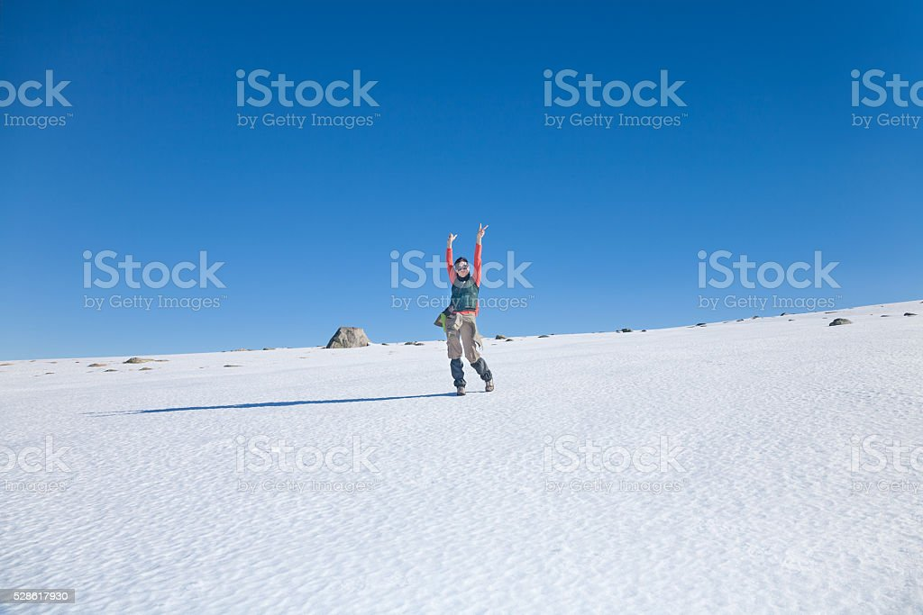 hiker woman greeting in snow stock photo