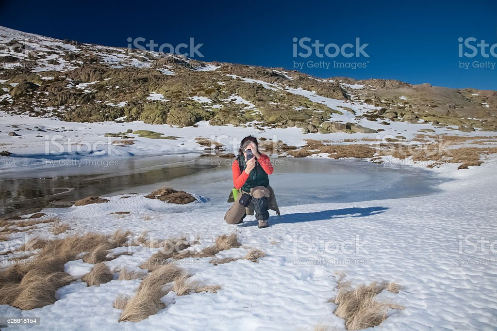 hiker woman photographing you stock photo