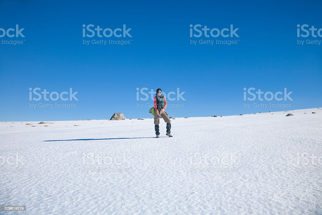 hiker woman standing in snow stock photo
