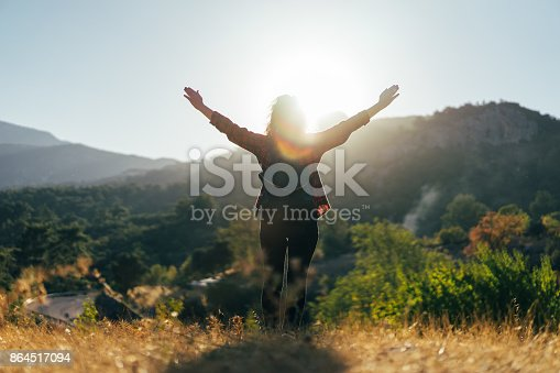 Hiker woman walking outdoor at sunset