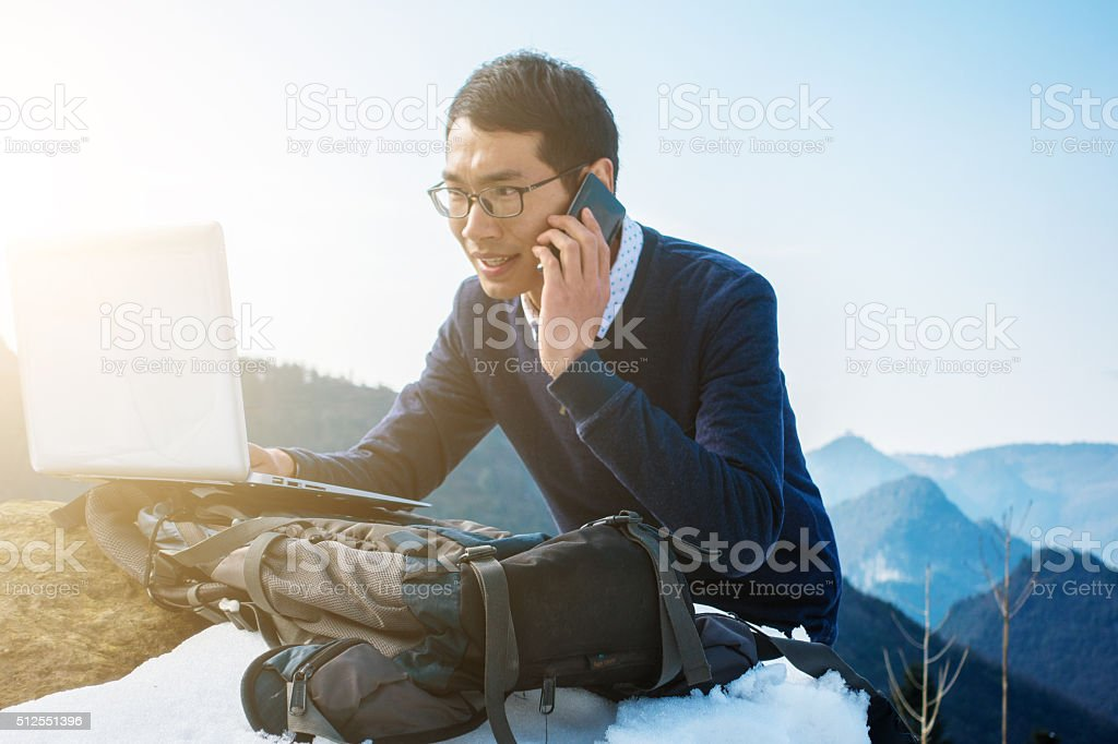 Hiker working outdoors stock photo
