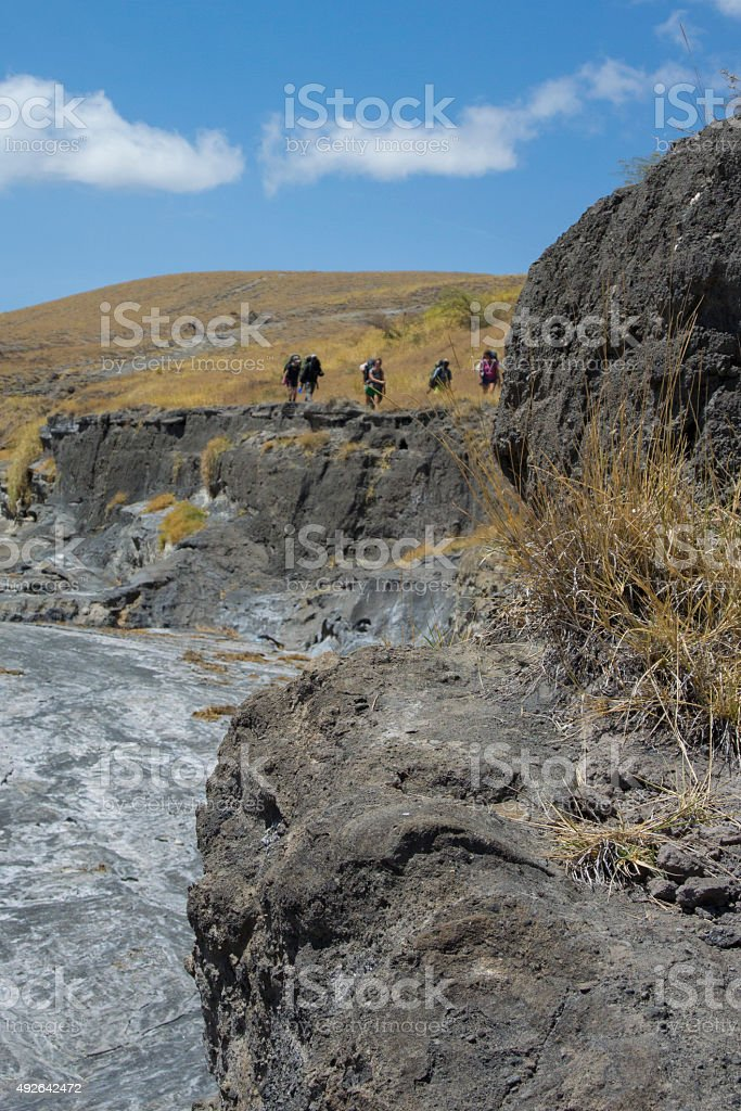 Hikers Above Gully stock photo