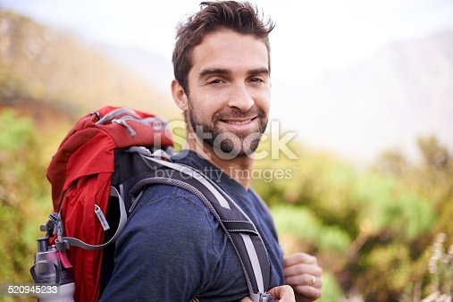 Shot of a man enjoying a hike on a sunny day