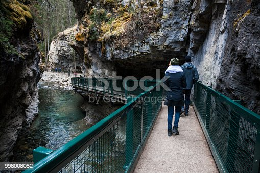 Hikers amongst the beautiful wilderness landscape of Johnston Canyon at Banff National Park in the Canadian Rockies in Alberta, Canada.