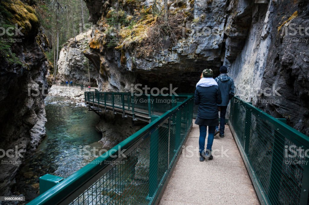 Hikers at Johnston Canyon in the Canadian Rocky Mountains, Alberta, Canada stock photo
