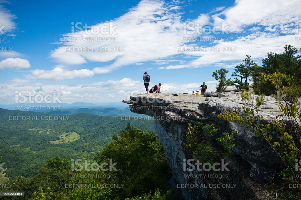Hikers at McAfee Knob on Appalachian Trail in Virginia stock photo