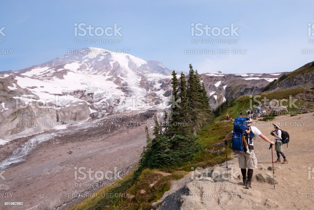 Hikers at Mount Rainier in Washington State stock photo
