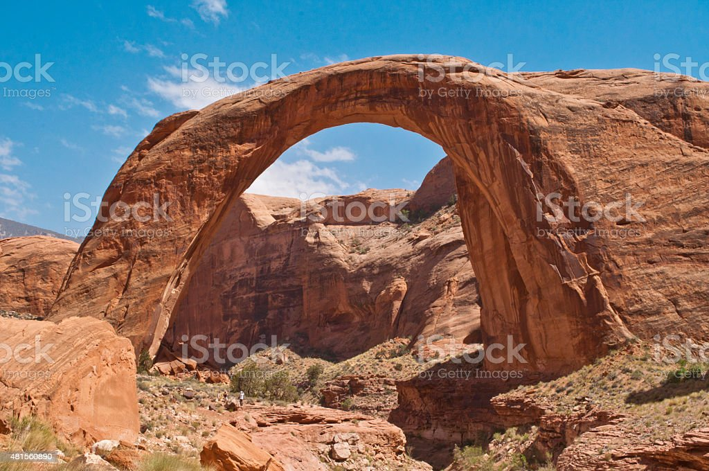 Hikers At Rainbow Arch, Arches National Park, Utah stock photo