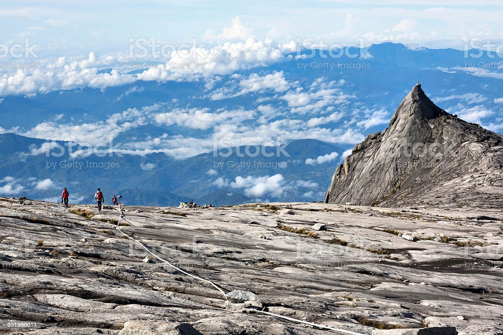Hikers at the Top of Mount Kinabalu in Sabah, Malaysia stock photo