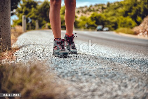 istock Hikers boots on a mountain road 1063695390