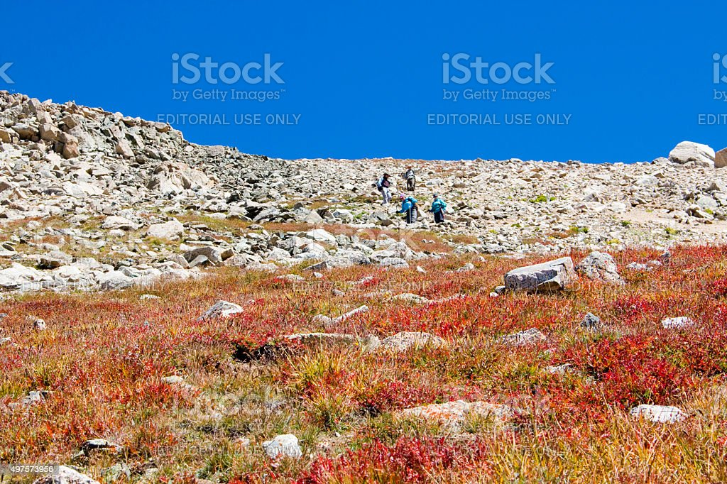 Hikers Climbing Down from Summit on Mount Yale Colorado stock photo