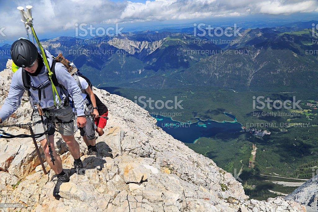 Hikers climbing near the summit of Zugspitze Mountain. stock photo