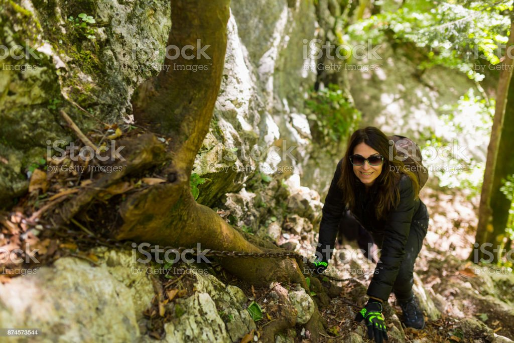 Hikers climbing on mountain wall stock photo