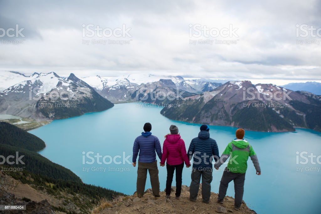 Hikers conquering adversity together stock photo