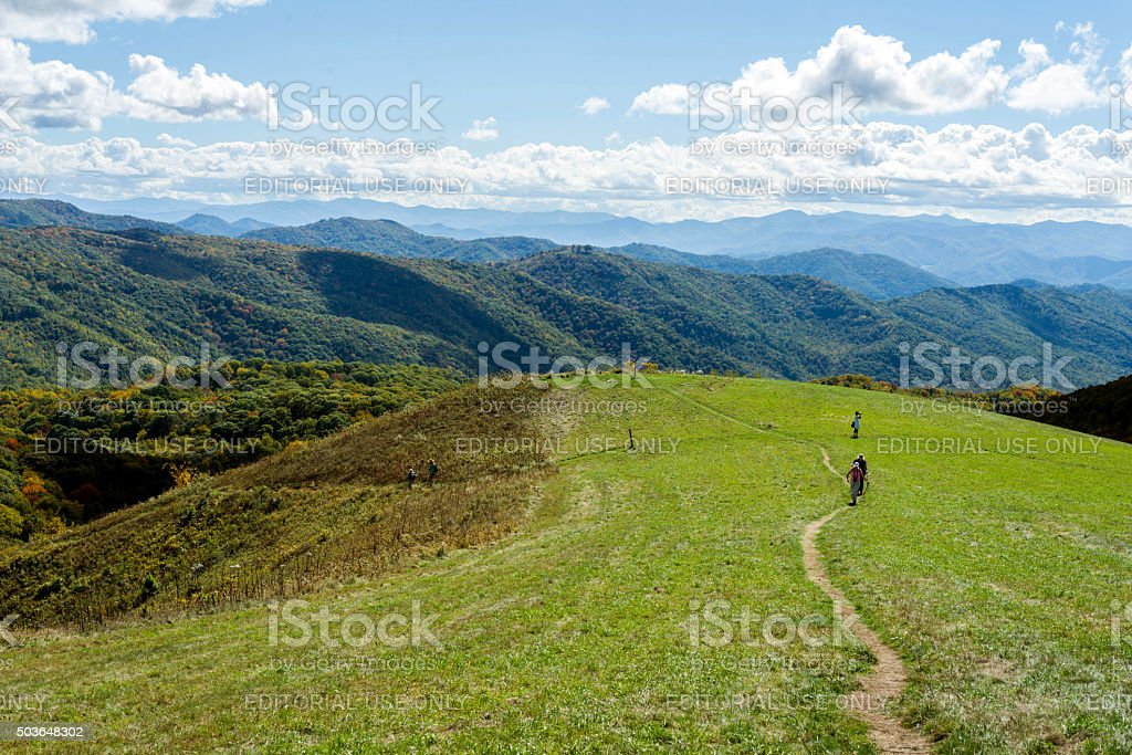 Hikers crossing a mountain bald stock photo