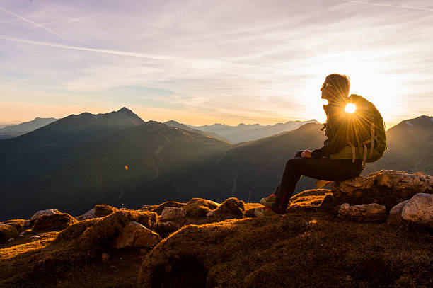 Hikers enjoy alps Hikers enjoy the mountain atmosphere. slow motion stock pictures, royalty-free photos & images
