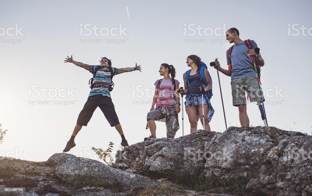 Hikers enjoying the success of making it to the top stock photo