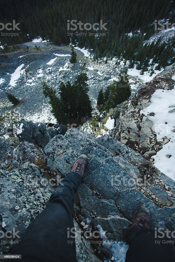 Hikers Feet Nearing the Edge of Cliff Drop off stock photo