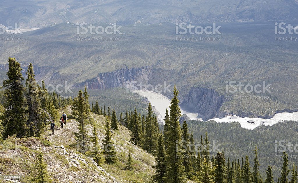 hikers going down mountain royaltyfri bildbanksbilder