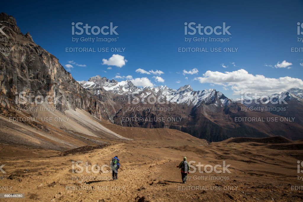 hikers in Bhutani Himalayas stock photo