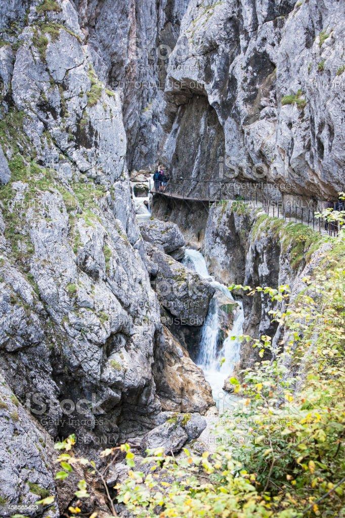 Hikers in Gorge Höllentalklamm, Germany royalty-free stock photo