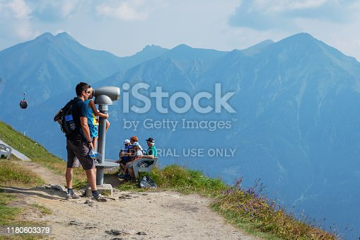 BAD GASTEIN, AUSTRIA - AUGUST 06, 2018: A hikers is looking into the distance.