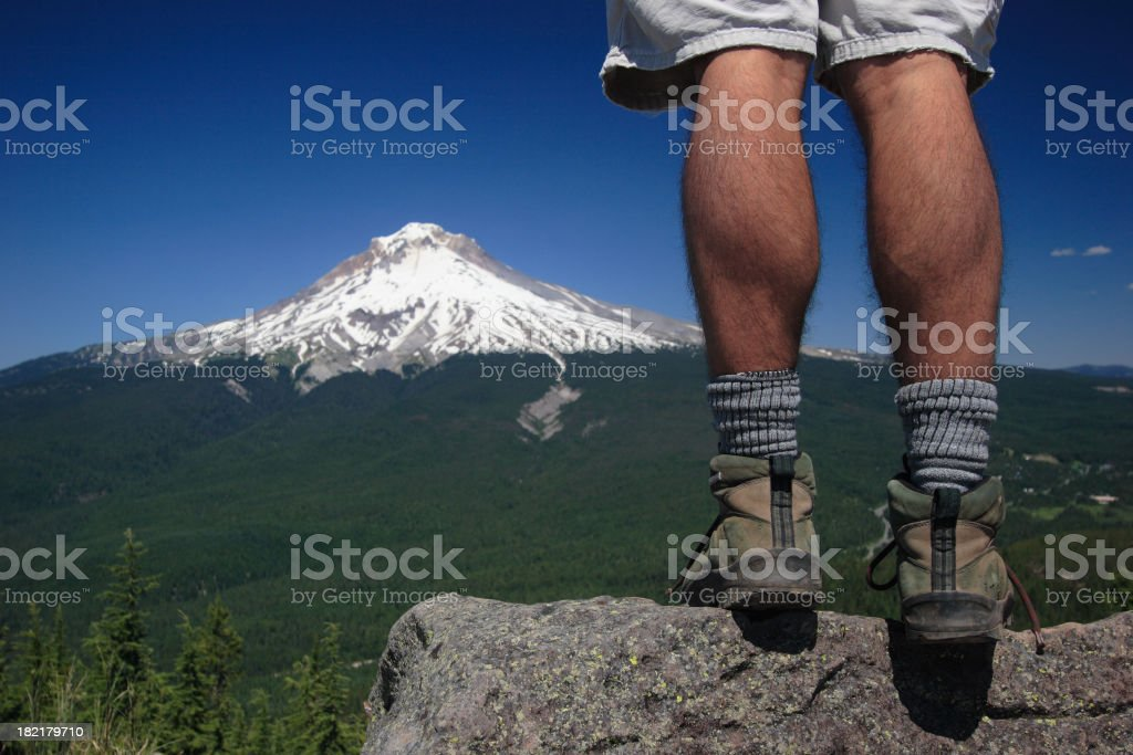 Hiker's Legs Overlooking Mountain royalty-free stock photo