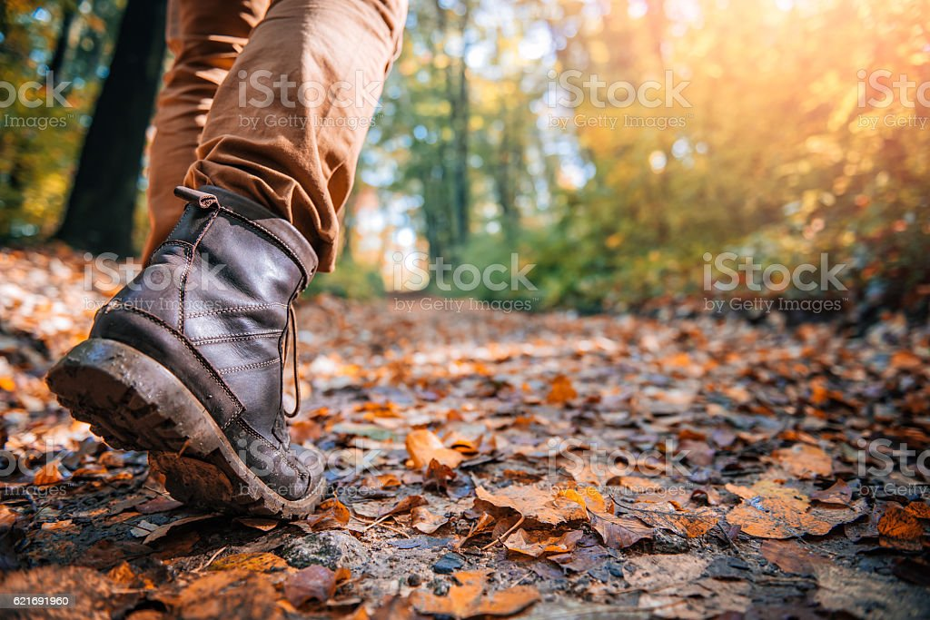 Hikers muddy boots stock photo